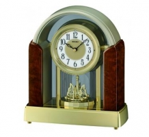 Melodies in Motion: Rotating Pendulum Mantel Clock